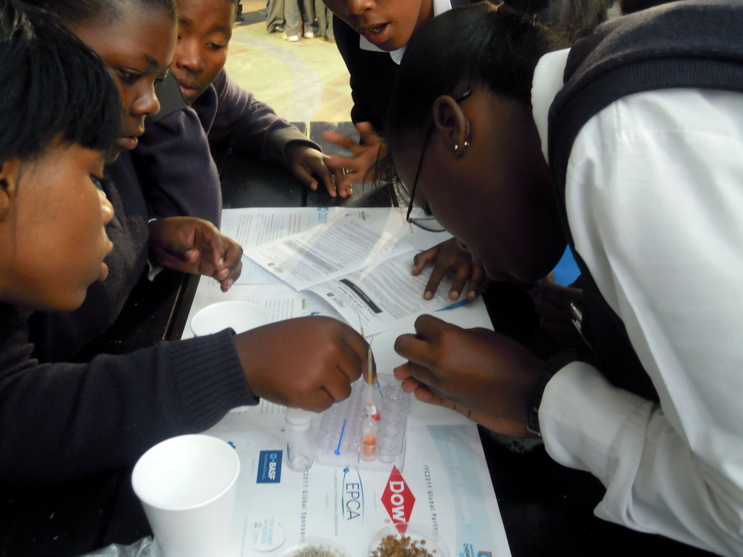 Secondary school learners engaged with RADMASTE microscale water activities.